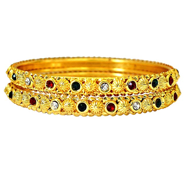 A Pair Of Gold Plated Bangle S