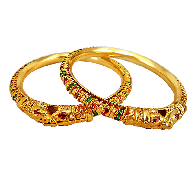 A Pair of Enamelled Lion faced 24 kt Gold Plated Bangles