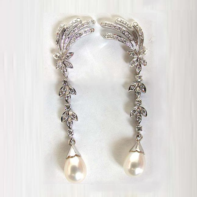 Bejeweling Brooks -0.62cts White I -VVS1 Diamond Earrings