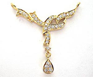 A Marvelous Diamond & gold Necklace Pennant Necklaces